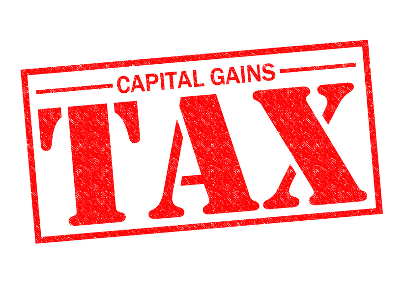 Capital Gains Tax Red Rubber Stamp Over A White Background